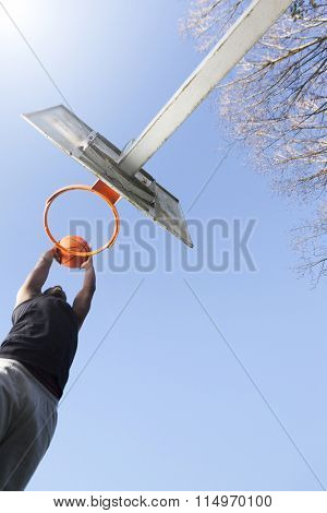 Basketball player jumping to dunk