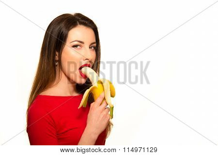 Sexy Woman In Red Clothes Eating Banana On White Background Isolated Looking At Camera