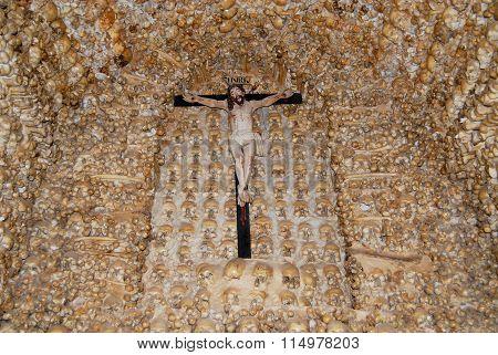 Human skulls and bones fixed in the wall of the Chapel of Bones (Capella dos Ossos) at Alcantarilha.