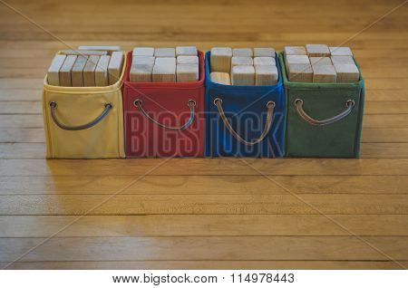 Multi-colored Bins Of Wooden Toy Blocks