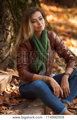Beautiful young blond woman in a park relaxing
