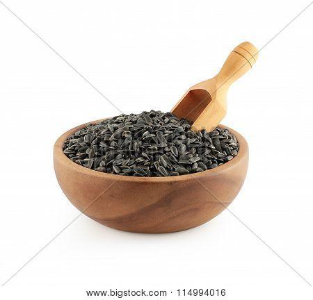 Wooden bowl full of Sunflower seeds