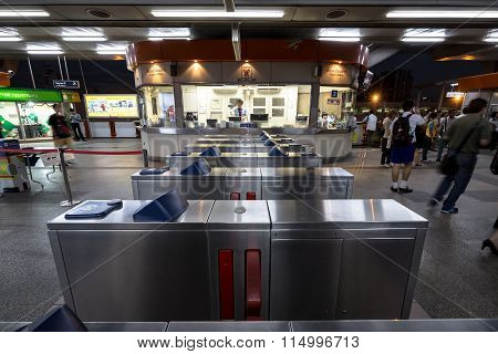 Ticket barriers machine at BTS public train station at night