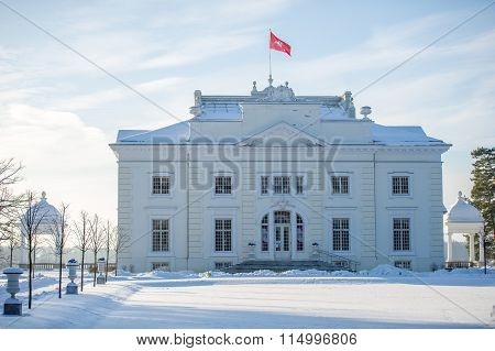 Uzutrakis manor estate in winter, Trakai, Vilnius, Lithuania, Europe. Uzutrakis manor ensemble was created in 1897-1902 by count Jozef Tyszkiewicz and his wife duchess Jadwiga Swietopulk-Czetwertynska poster