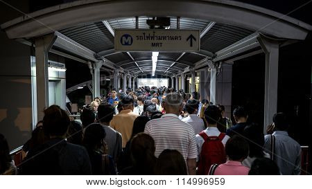crowd of people in rush hour at BTS public train station at night