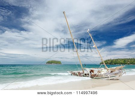 Kata beach in Phuket island in Thailand, crashed yacht