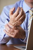 Businessman Suffering From Repetitive Strain Injury (RSI) poster