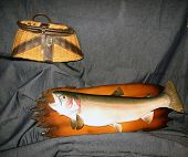 mounted rainbow trout and old weathered creel.this is a fish i caught in 1984 while vacationing in michigan. poster