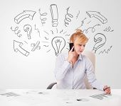 Attractive young businesswoman brainstorming with drawn arrows and symbols poster