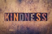 "The word ""Kindness"" written in dirty vintage letterpress type on a aged wooden background. poster"