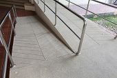 ramp way for support wheelchair disabled people made from sand and small gravel stone washed floor poster