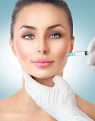 Beautiful woman gets beauty facial injections. Face aging injection. Aesthetic Medicine, Cosmetology poster