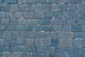 Background of sett. Cobblestone pavement. Texture. Close up poster