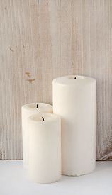 Thick White Candles On A White Wooden Background