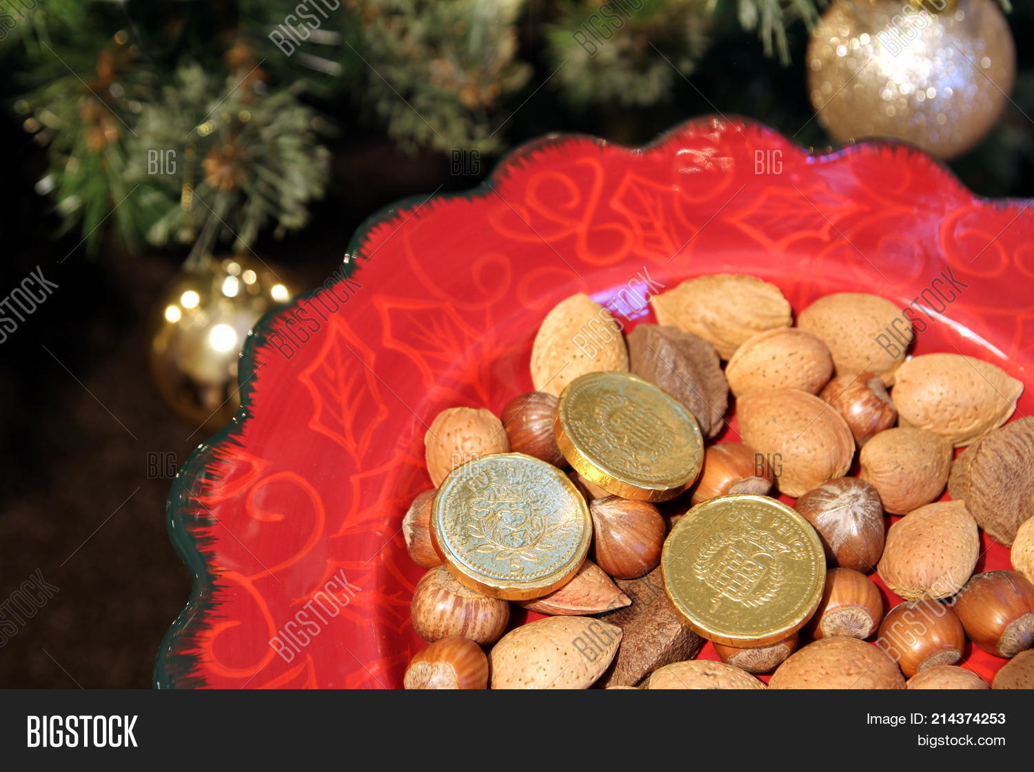 pretty red christmas plate with traditional festive almonds hazelnuts and brazil nuts and chocolat - Christmas Traditions In Brazil