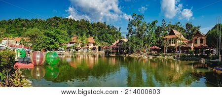 Langkawi, Malaysia - February 16, 2016: Oriental Village gateway to ride a cable-car up Mat Cingcang mountain. Luxury Paradise by the lake, restaurants, spa home, hotels and shops for tourists