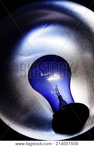 image of the dark blue lamp , abstract background