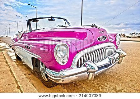 HAVANA CUBA- JANUARY 27 2013: Old retro car on the street in Old Havana Cuba. hdr effect