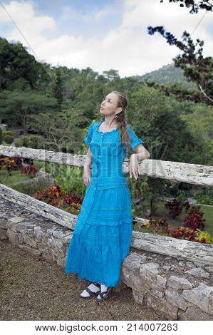 the woman in a long dress near waterfalls Soroa Pinar del Rio Cuba