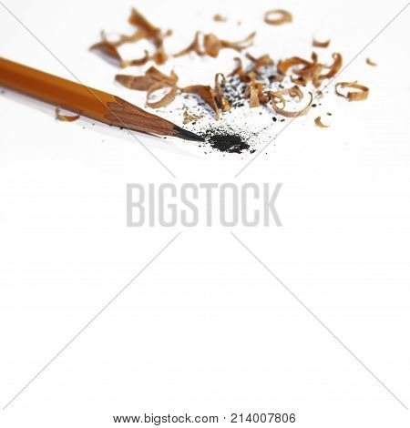 border with sharpened pencil and shavings isolated on white background