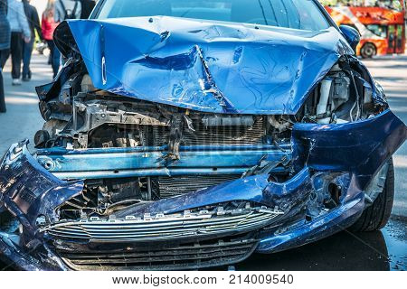 Crashed car after accident on road, dangerous driving concept