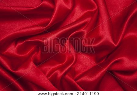 Holiday background - red silk drapery fabric