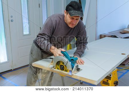 Wood Door Cuts Circular Saw Hands Of The Builder, Repair And Construction Tool