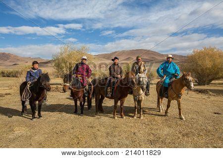 BAYAN-OLGII, MONGOLIA - SEP 28, 2017: Kazakh Eagle hunters on horseback. In Bayan-Olgii Province is populated to 88,7% by Kazakhs.