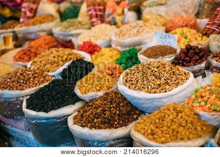 Tbilisi, Georgia. View Of Persian English Common Walnut Juglans Regia , Succade And Dried Fruits In Bags On Showcase Of Local Food Market.