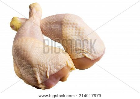 Two fresh raw chicken legs or thighs isolated on white background.