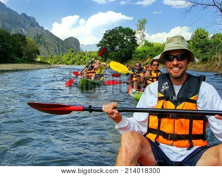 Vang Vieng, Laos - November 27: Unidentified People Go Down Nam Song River In Kayaks On November 27,