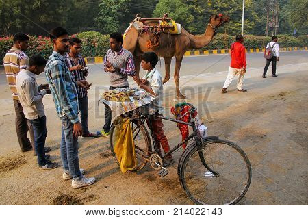 Agra, India - November 8: Unidentified Men Eat Chaat (indian Snack) In Taj Ganj Neighborhood On Nove