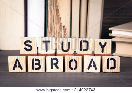 study abroad, wooden letters on wooden table. Education, success and communication background.