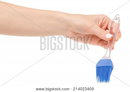 Silicone kitchen brush in hand on a white background isolation