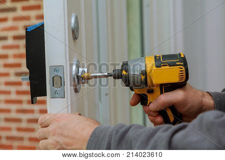 Install The Door Handle With A Lock, Carpenter Tighten The Screw, Using An Electric Drill Screwdrive
