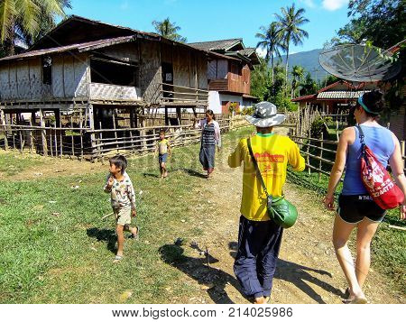 Vang Vieng, Laos - November 27: Unidentified People Walk Through The Village In The Countryside On N