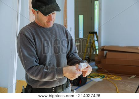 A Carpenter Works On Woodworking Man Collects Furniture Boxes.
