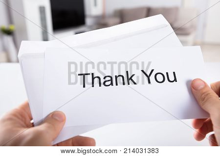 Close-up Of A Person's Hand Holding Thank You Card