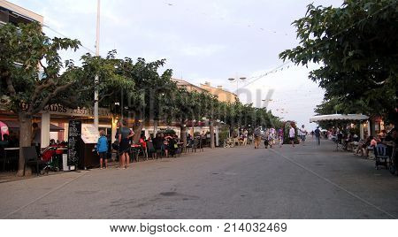 Valras-plage, Herault, France - Aug 27 2017: Tourists And Locals Walk Among Restaurants And Cafes On