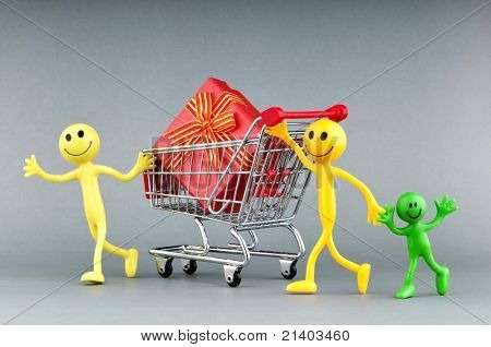 Smileys with gift box in the shopping cart
