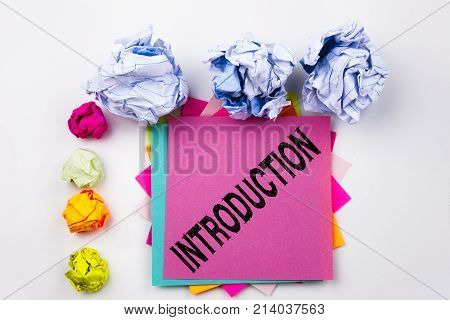 Writing Text Showing Introduction Written On Sticky Note In Office With Screw Paper Balls. Business