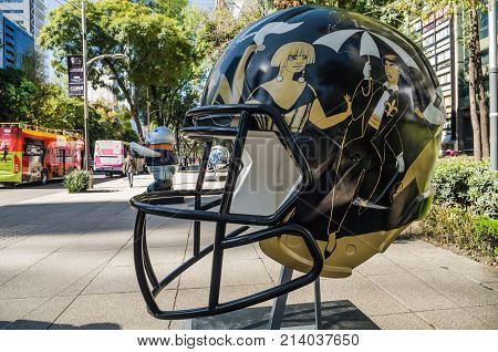 REFORMA AVENUE MEXICO CITY - NOVEMBER 13 2017. On the occasion of the match between Patriots and Raiders at the Aztec Stadium the NFL organized the Ball Parade with 42 pieces of 32 mexican artists.