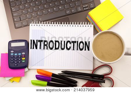 Introduction Text In The Office With Surroundings Such As Laptop, Marker, Pen, Stationery, Coffee. B