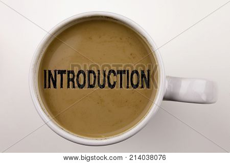 Introduction Writing Text In Coffee In Cup. Business Concept For Starting Firs Experience On White B