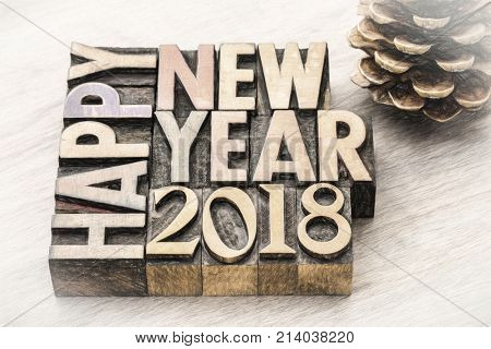 Happy New Year 2018 greeting card - text in vintage letterpress wood type blocks, charco painting digital effect