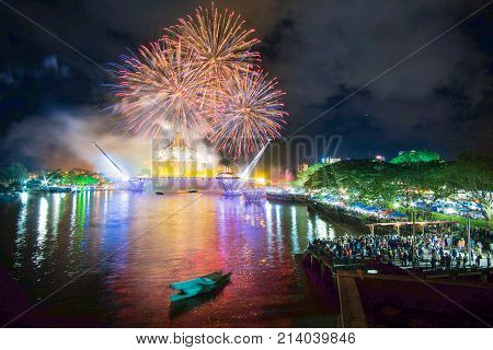 Kuching sarawak,malaysia november11 2017 : a awesome fireworks show in conjunction with the inauguration of a new bridge facing the Sarawak state assembly.happy new year .concept celebration