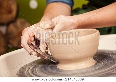 Woman Potter Teaches