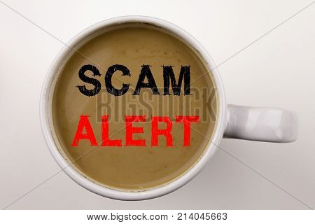 Scam Alert Writing Text In Coffee In Cup. Business Concept For Scam Alert On White Background With C