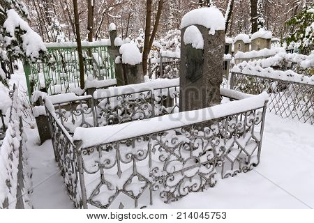 NIZHNY NOVGOROD, RUSSIA - NOVEMBER 07, 2016: The grave of russian writer Pavel Melnikov (Pechersky) at the Red cemetery. Melnikov best known for his novels which describe the unique life of Transvolga