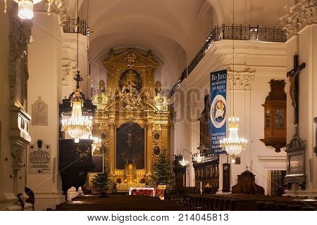 WARSAW, POLAND - JANUARY 02, 2016: Interior of the Roman Catholic Church of the Holy Cross (XV-XVI cent.) in Christmas decorations. Is a one of the most notable Baroque churches in Poland's capital.